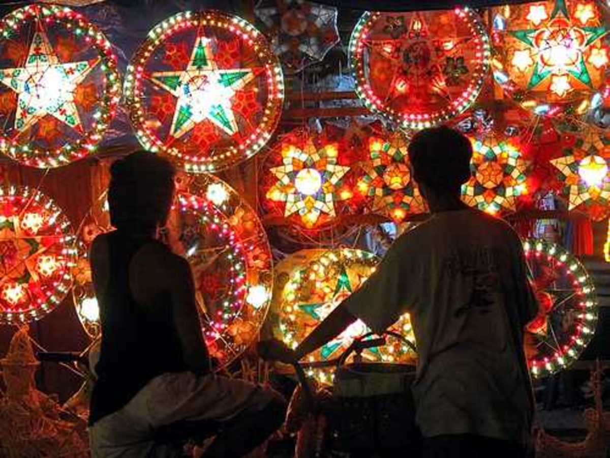 Parol (Christmas Lanterns). Seen here are the lighted ones as two kids are looking on.