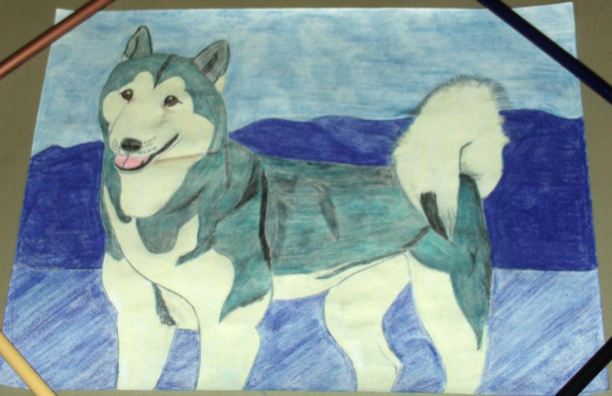 In this step I used the purple colored pencil to lightly color in the valley directly behind Natasha dog.  I continued to smooth out the crumbled page as I colored the picture, and used pencils to hold it down and keep it flat.