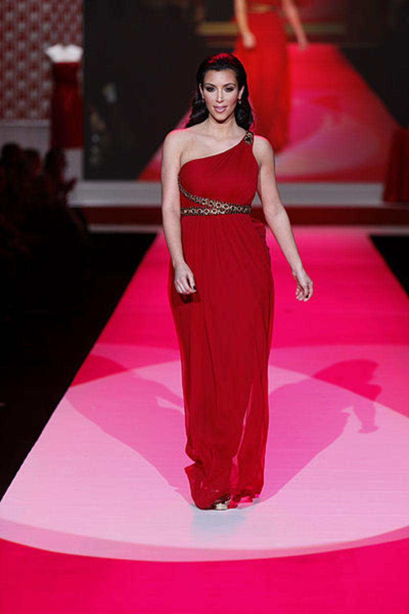 Kim Kardashian's lovely figure in a long red dress.