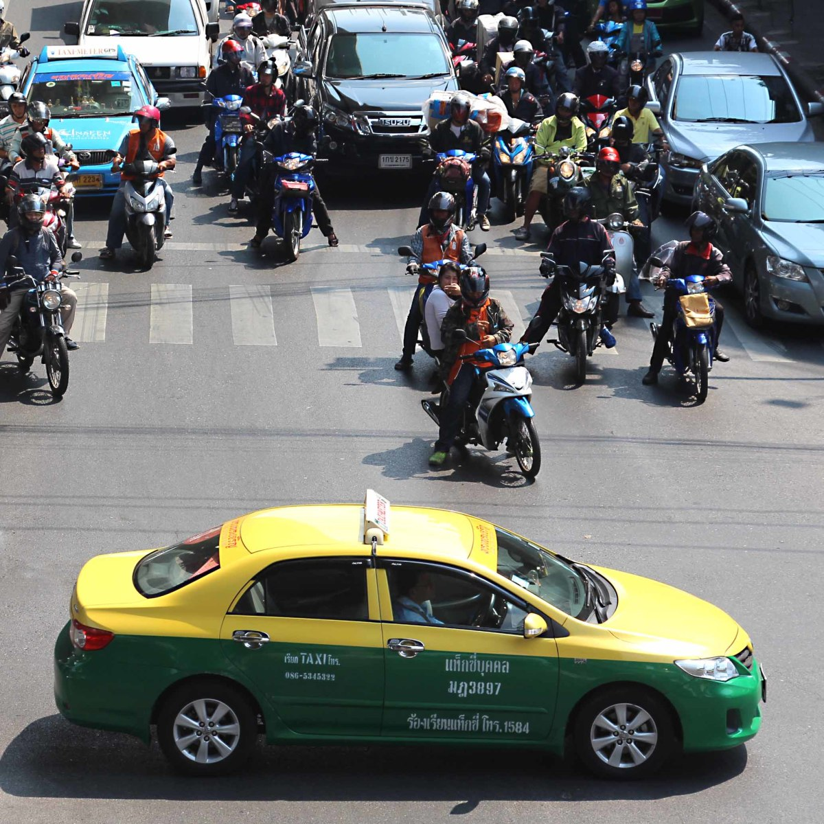 One of the green-and-yellow taxis