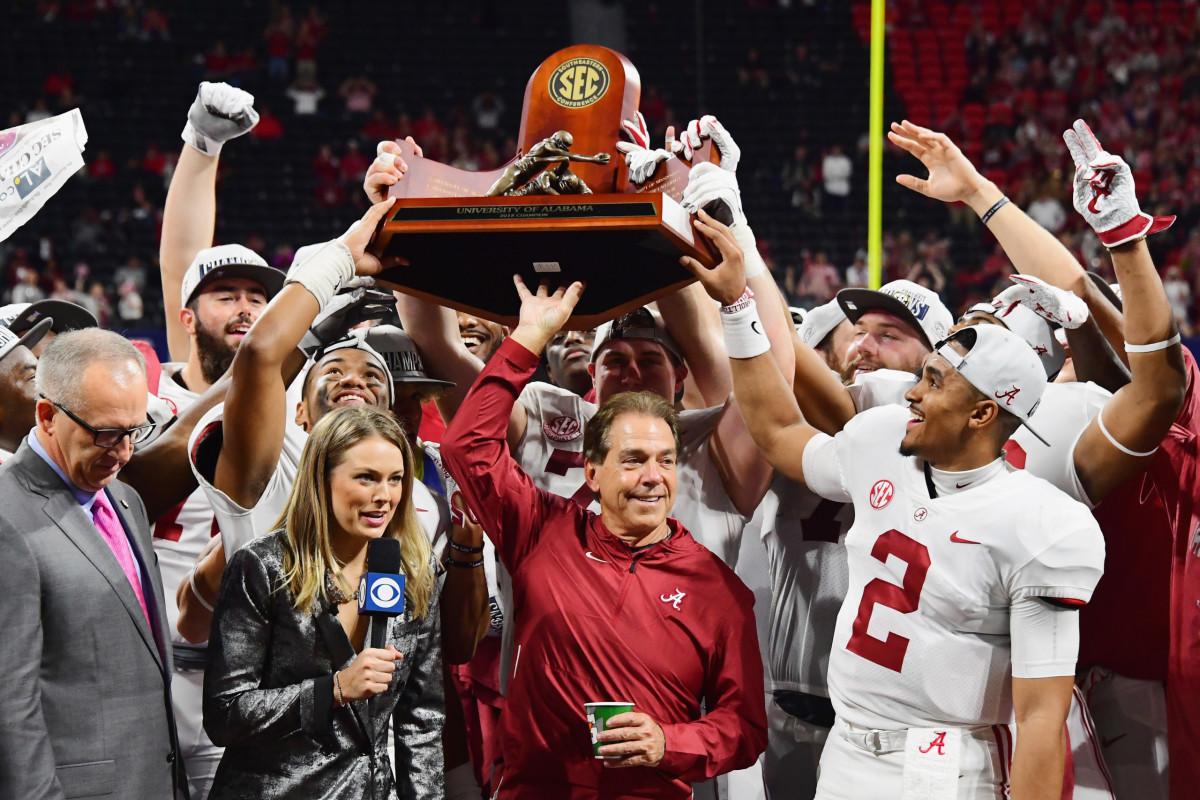 Saban hoisting the 2017 SEC Championship Trophy won at Alabama.