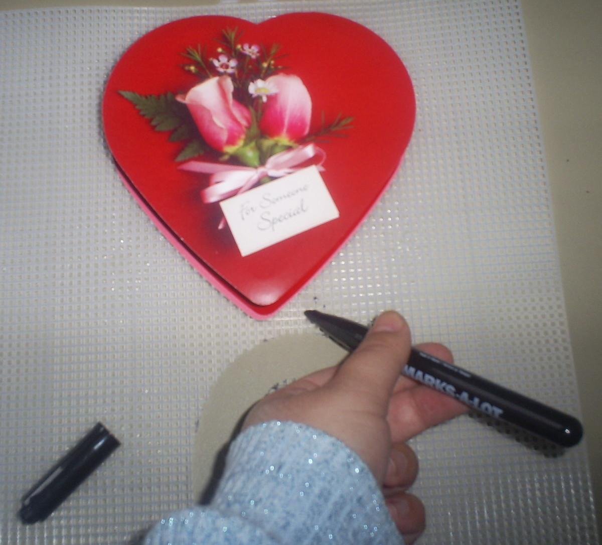 Trace around the heart shape box.