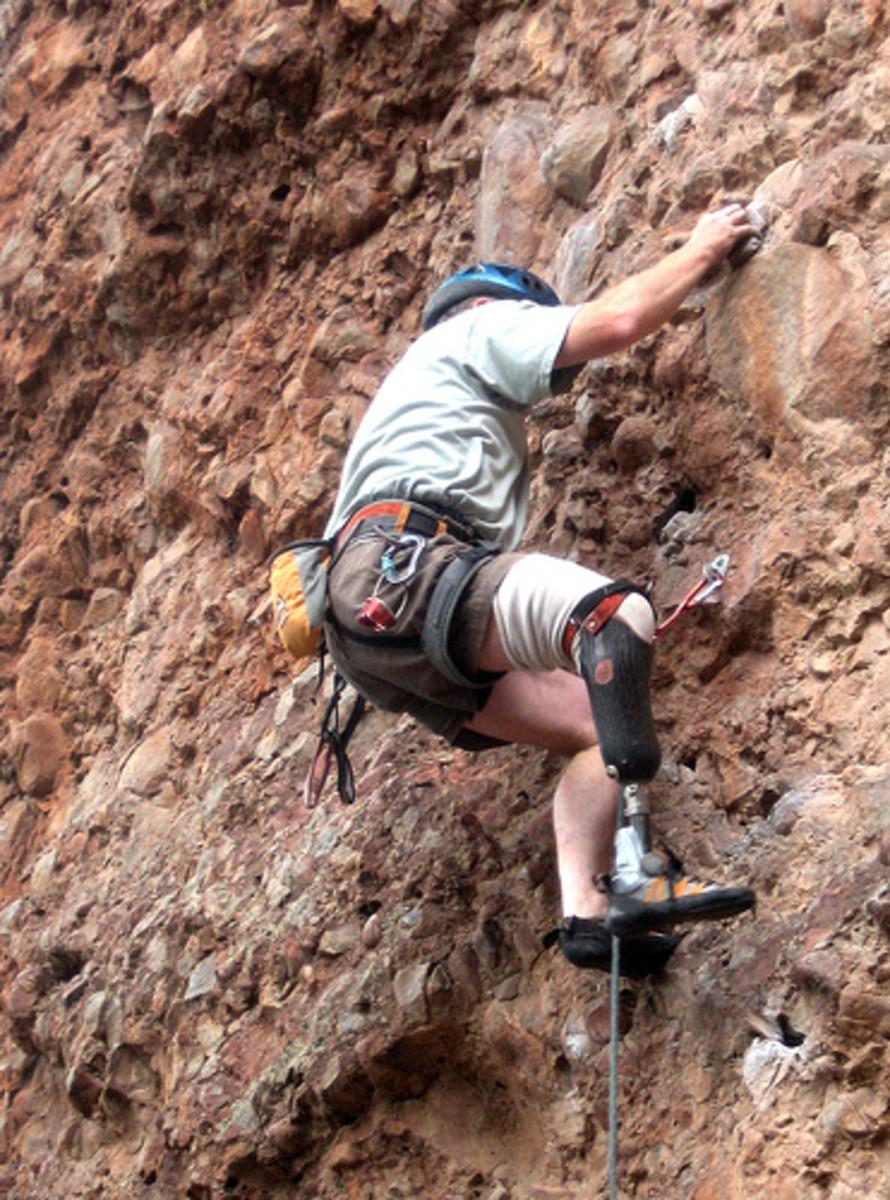 Amputee rock climbing