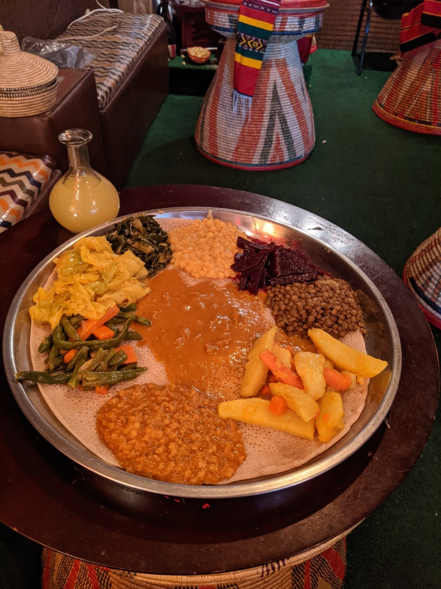 Close up of the platter with our lunch.  Yellow globe contains the Tej (Honey Wine) which is served in the round container with the thin neck.