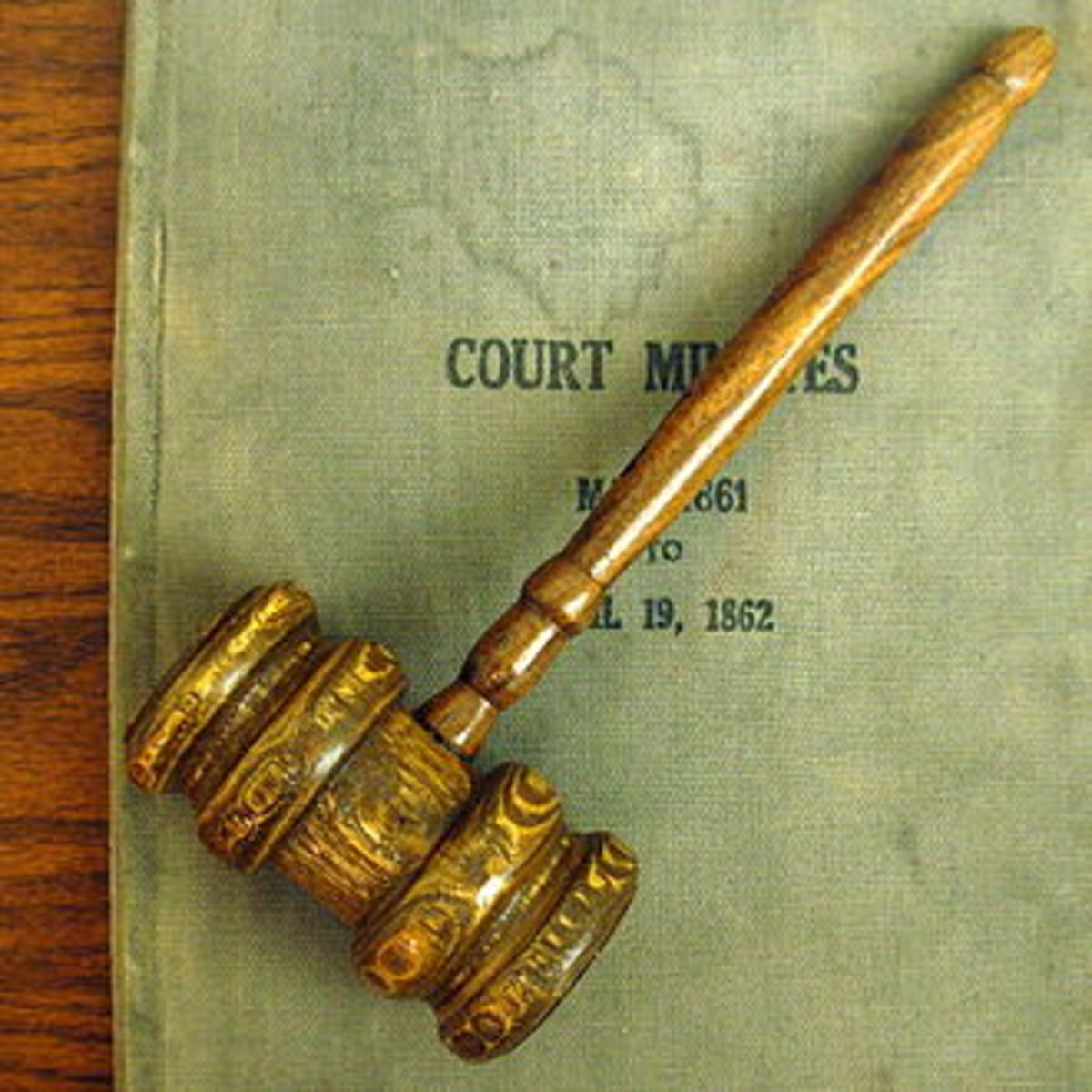 Old gavel and court minutes displayed at the Minnesota Judicial Center