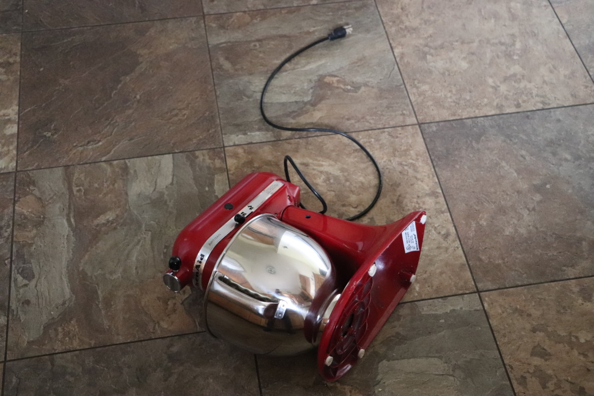 Our stand mixer crashed to the floor, damaging a tile. Fortunately, no one was injured and no damage occurred to our KitchenAid in the fall from the counter.