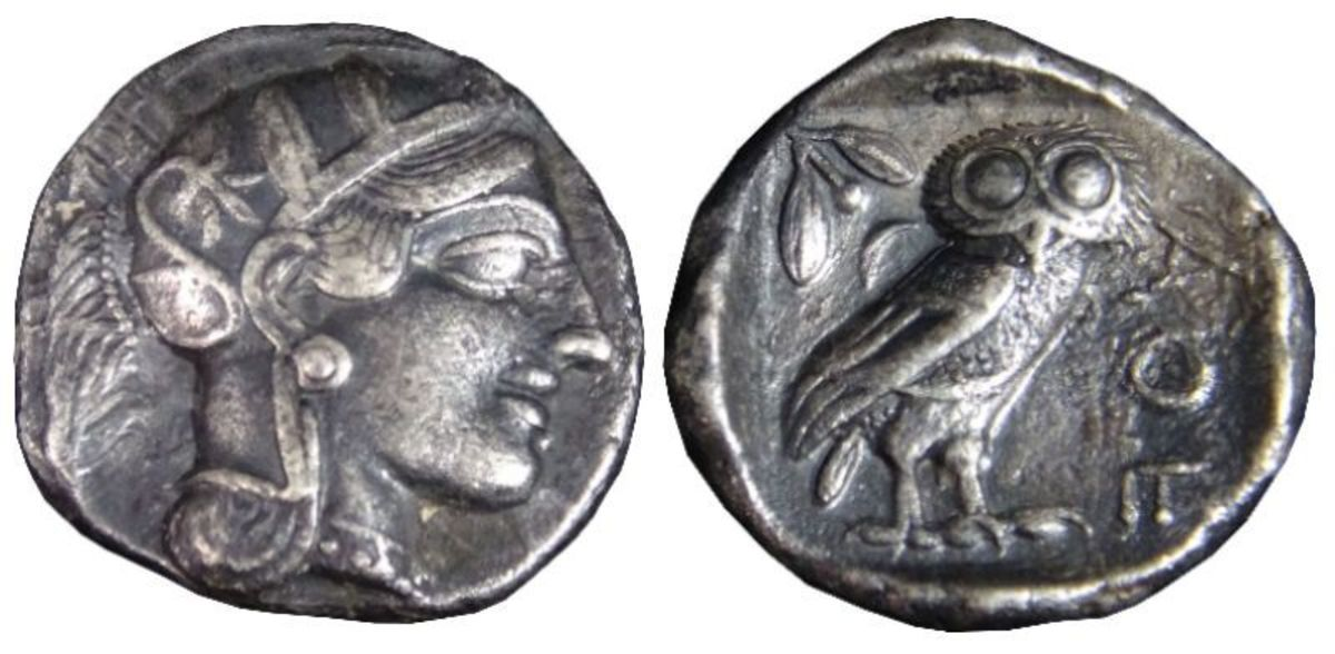 """An Athenian """"Owl"""" tetradrachm from after 499 BC, showing the head of Athena and the owl on the reverse."""