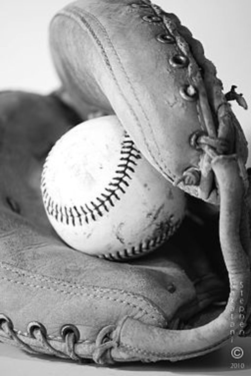 Baseball mitt and ball