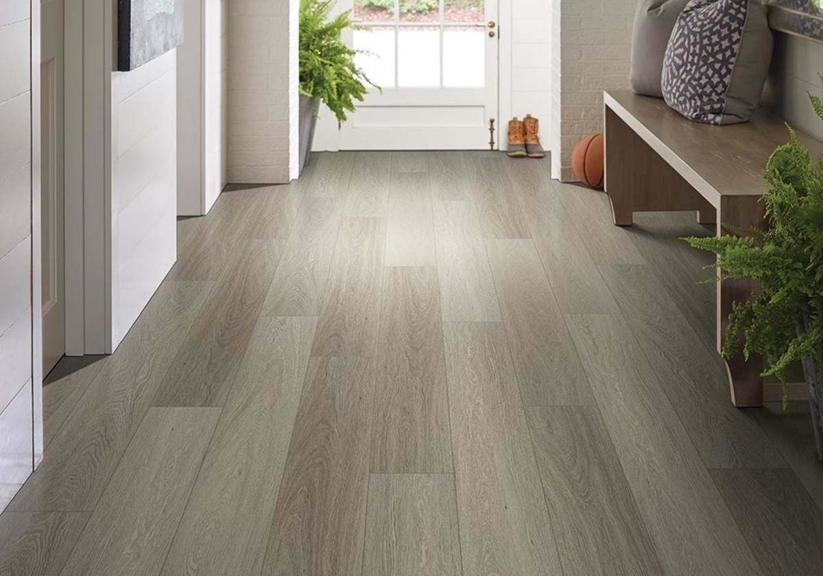 One of the moisture tolerant flooring options is luxury vinyl. Many of the lines are totally water resistant.