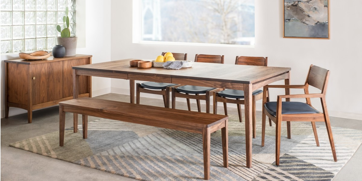 Handcrafted solid wood is inspired by Mid-Century modern wood furniture. The dining table is the solid top and has the extension leaves.