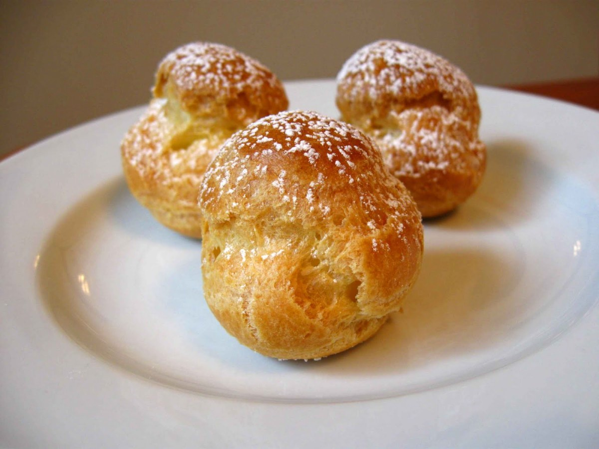Cream Puffs Dusted with Powdered Sugar