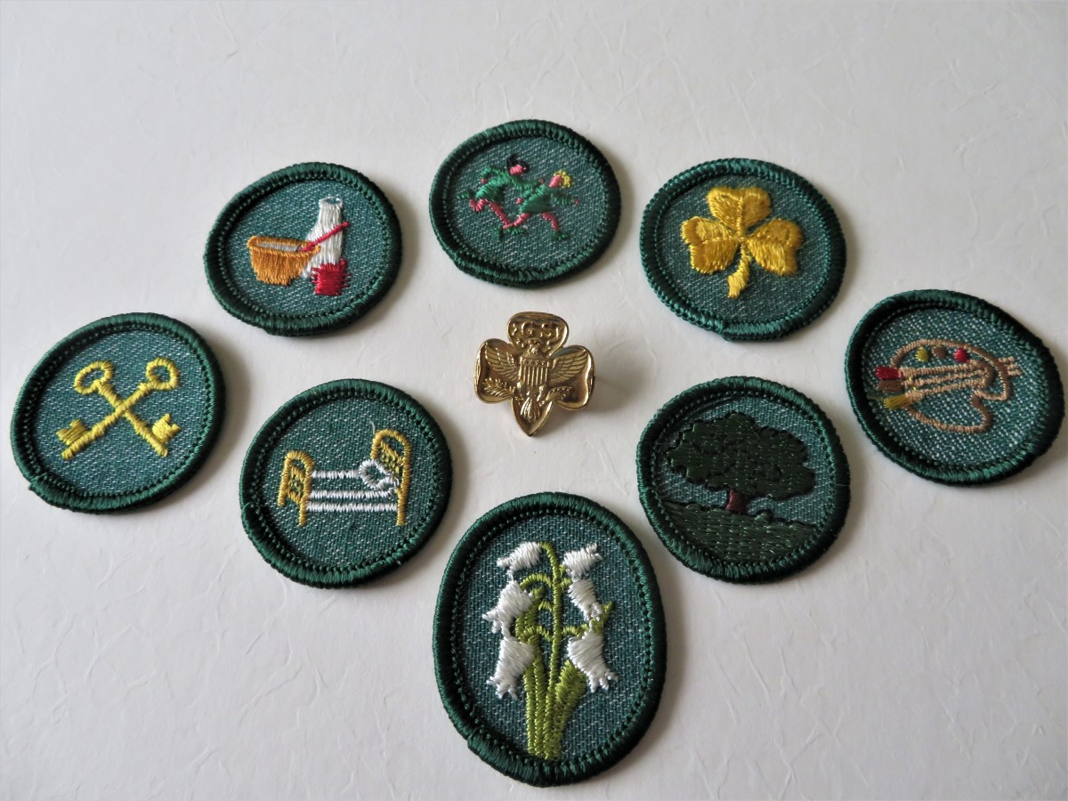 My girl scout pin and some of my badges from the 1950s