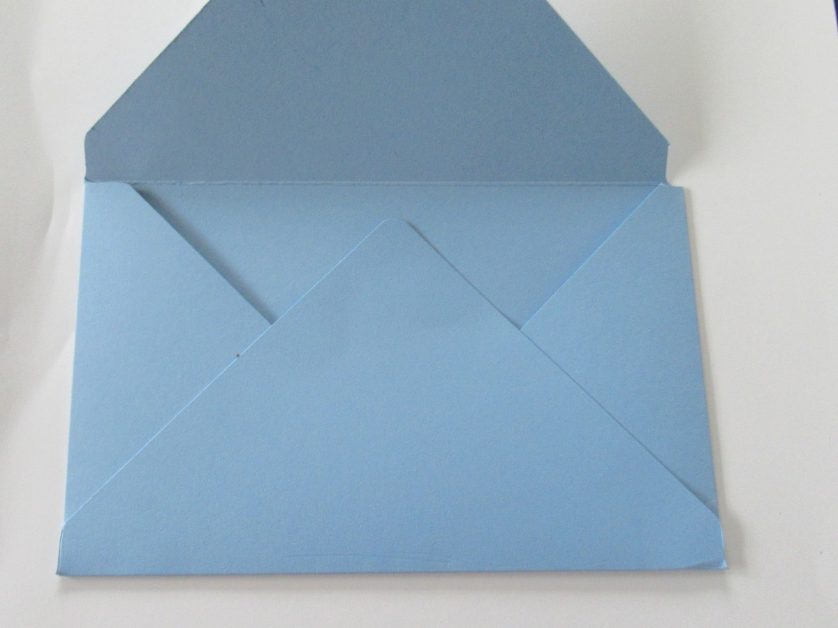 Finish your envelope by using double-sided tape or glue to secure the flaps