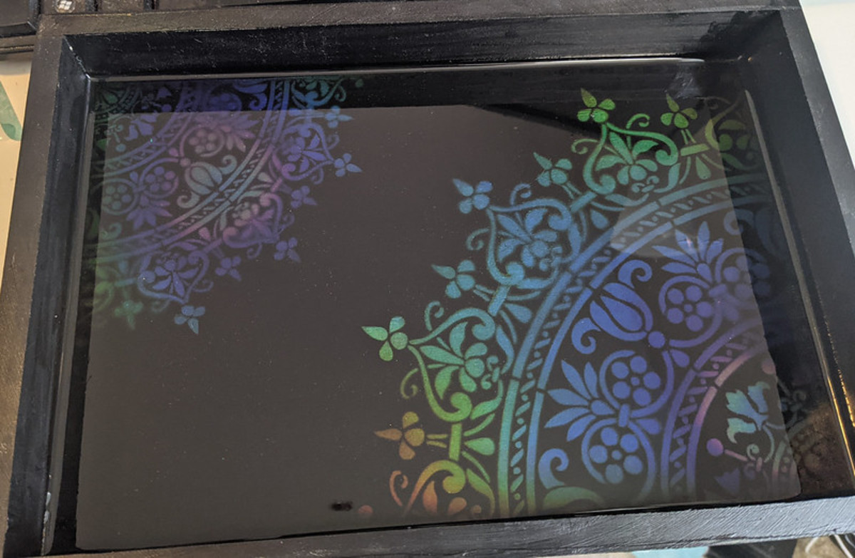 It can be difficult to capture the color changes in a picture, but I also made a tray by airbrushing over a stencil and coating in resin. You can get the effect here in the morning sun.
