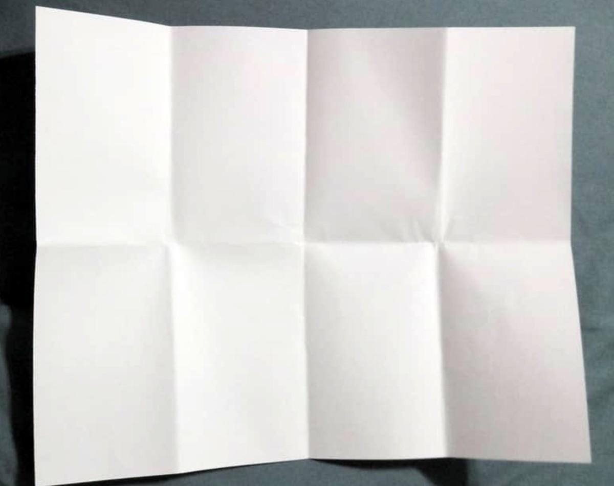 Fold in half.  Then fold in half again.  Then fold in half, again.