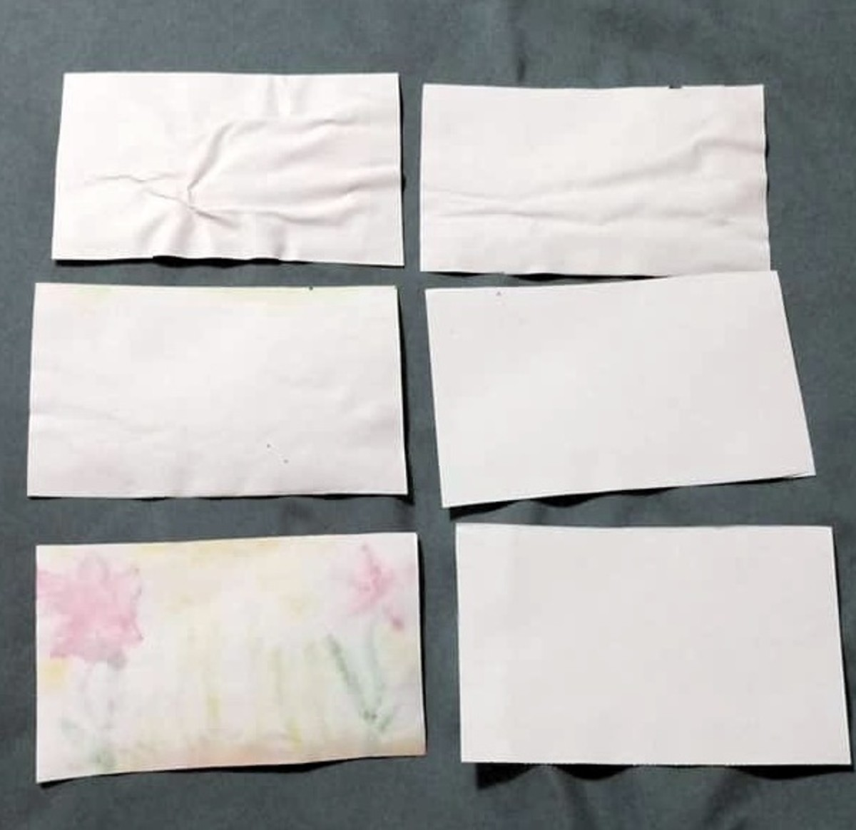 Cut the sheet of paper into 8 equal parts. There are only six shown here, but you should have 8.