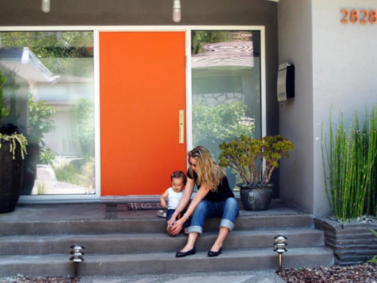 Painting your front door adds immediate steps appeal, the orange door for the front door color.