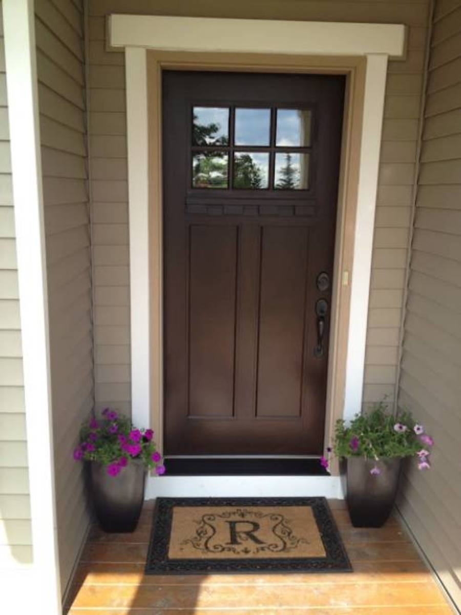 The dark brown door is a paint shade. The chocolate-brown door paint with a hint of adds a harmonious element.