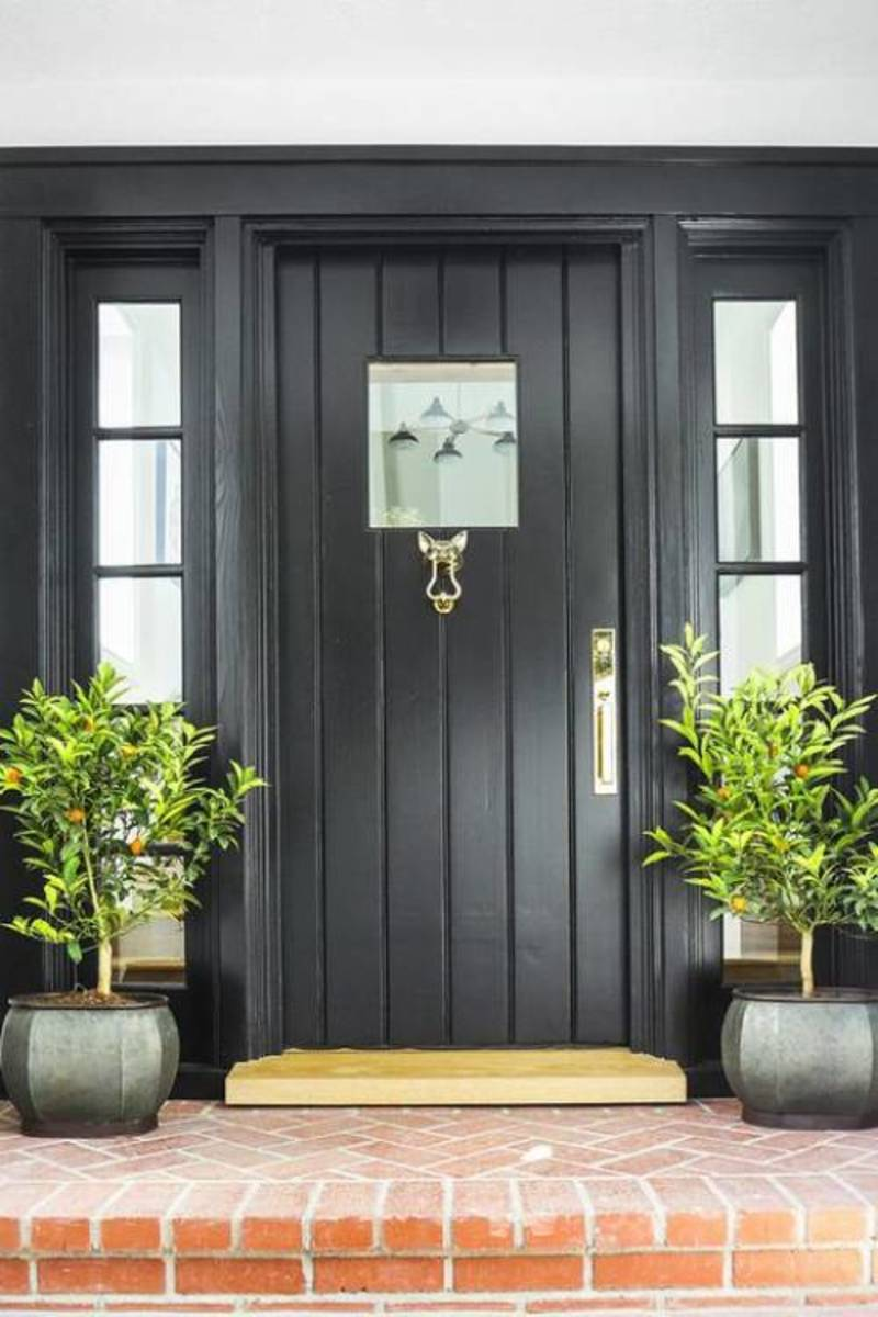 Similar to this dark black gray front door paint makes a dramatic statement against light siding or wood.