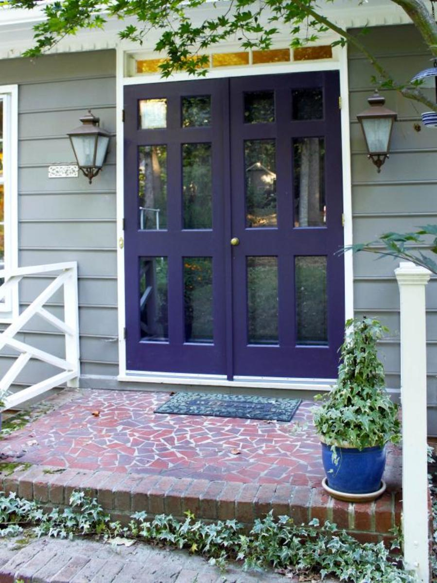 Purple is a versatile color that can represent imagination, royalty, wonder, intrigue, and elegance all at once. This purple door is a great example of what I'm talking about. It's at once trendy, chic, and fresh.