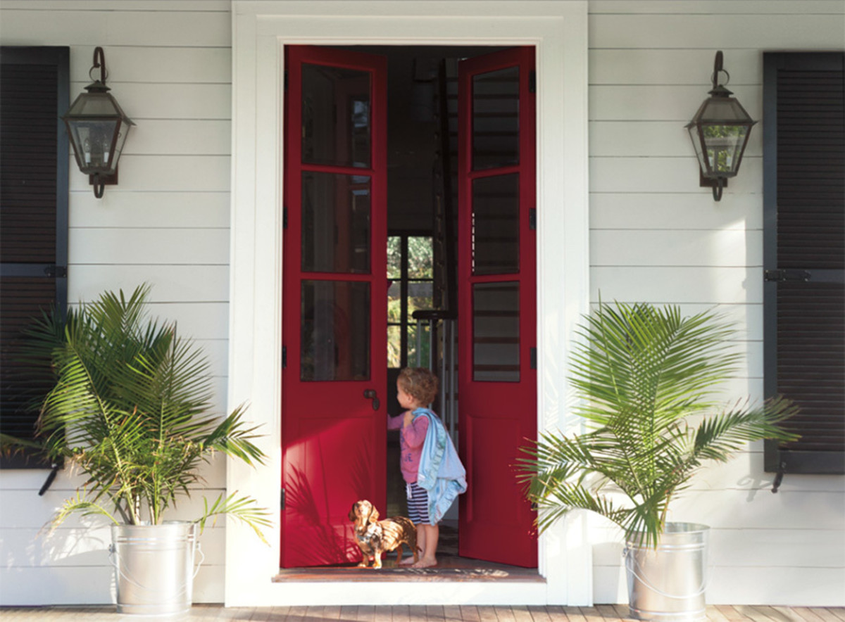 Give your front door a dose of fresh burgundy color to perk up a home's exterior and a gracious welcome.