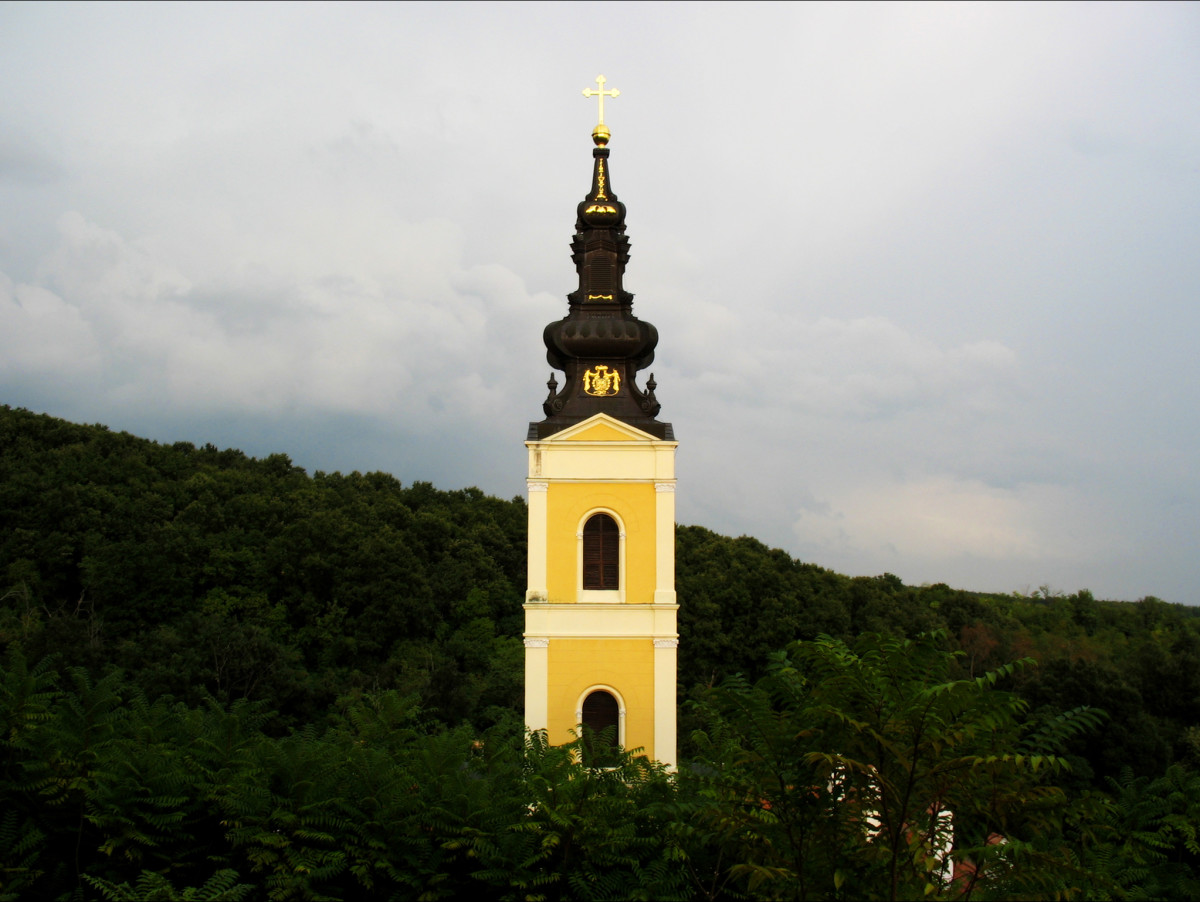 The bell tower of the Monastery Grgeteg rises above the rest of the monastery complex.