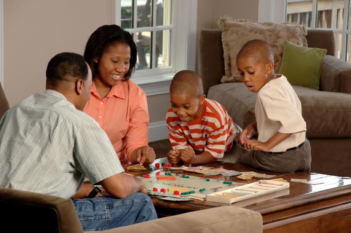 Family game and movie nights at home are a great way to chill out together on a budget.