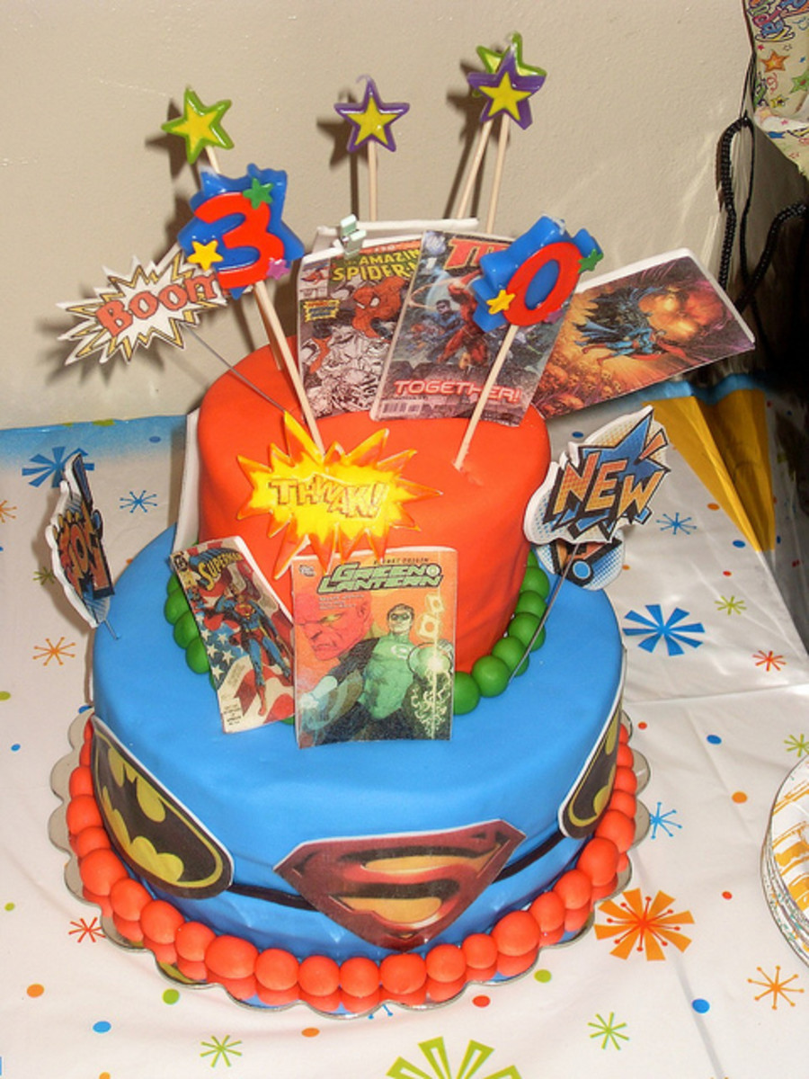 Super hero cake featuring batman, Superman, green latern etc. Highlights include the comic book decorations and the cake toppers