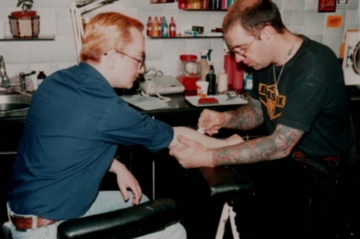 Lal transferring the drawing to James's arm