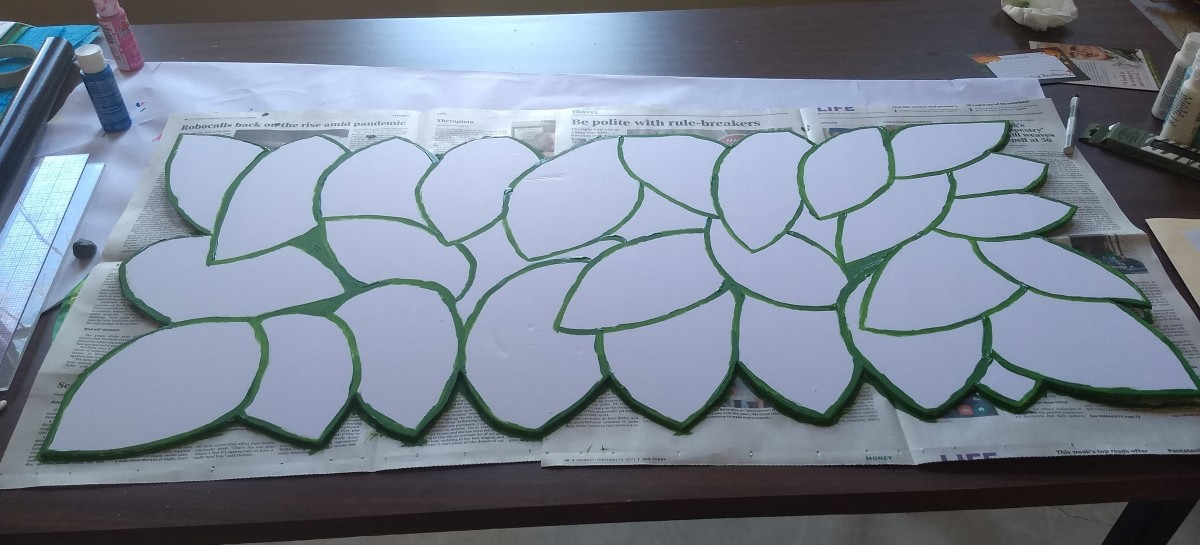 This is an in-progress shot of the leaves we created to modify the Lenten panels into Easter panels.