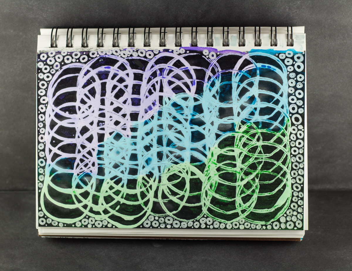 I used a cardboard tube to create the circles on this sketchbook page.