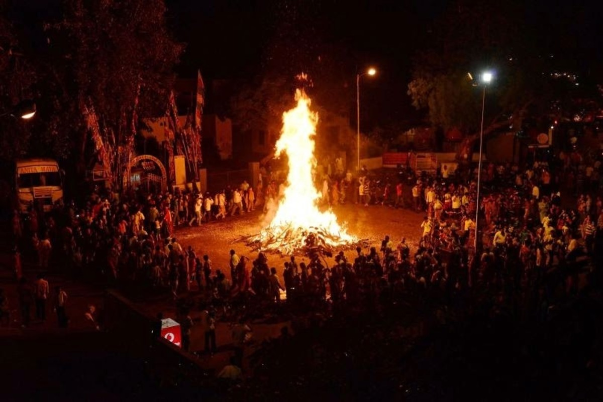 A Typical Holi Bonfire with people offering prayers and pooja ....