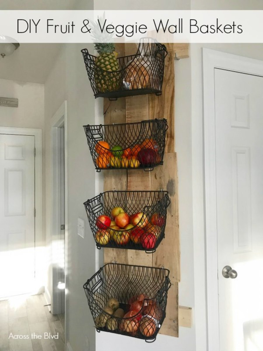This DIY wall mounted fruit and veggie holder is a stylish and convenient way to store fruits and vegetables.