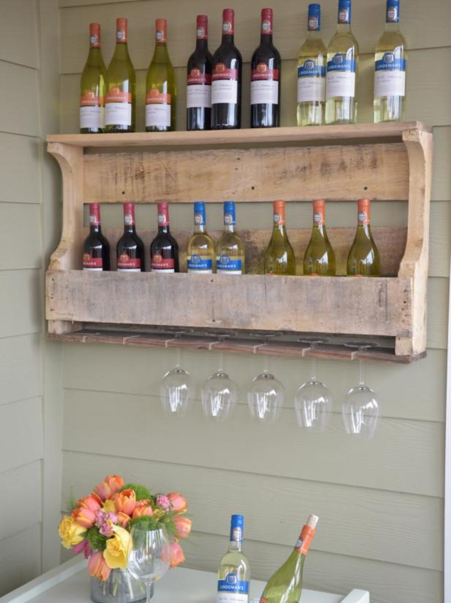 Transform an ordinary wooden pallet into a rustic outdoor wine rack that can accommodate at least several bottles of wine as well as stemware.