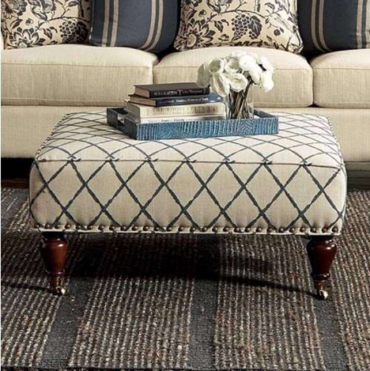 Make an upholstered storage ottoman out of  the coffee table.