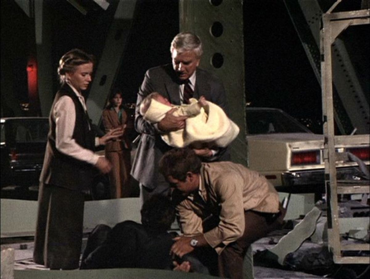 Terry (Eve Plumb) gets ready to take Paul's (Leslie Nielsen) sick baby from him as Cal Miller (James MacArthur) attends to fallen police officer Harvey Lewis (Richard Gilliland) before putting him in the Breeches bouy as Dee (Char Fontane) looks on