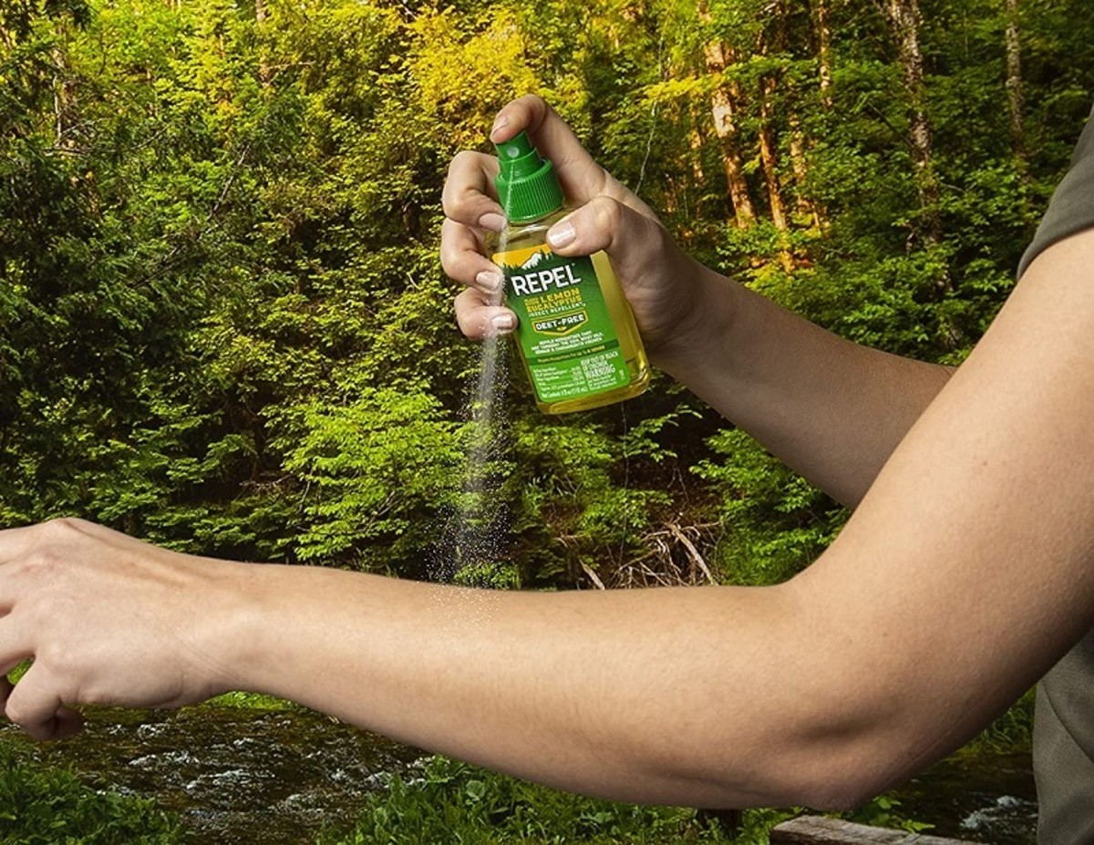Spraying insect repellent on exposed skin helps deter biting insects.