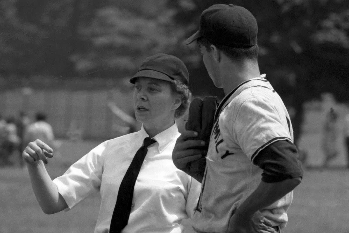 Bernice Shiner-Gera speaking with a player during a baseball game