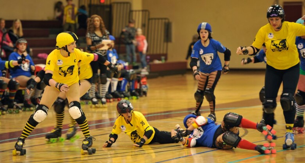 KimChicks and Rokettes roller derby teams compete during at U.S. Army Garrison Humphreys, Republic of Korea, March 8, 2014.