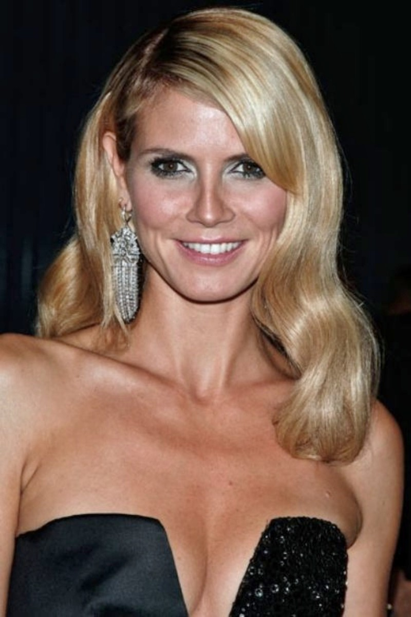 Heidi Klum with light ash blonde hair, long, side-parted, and slightly wavy.