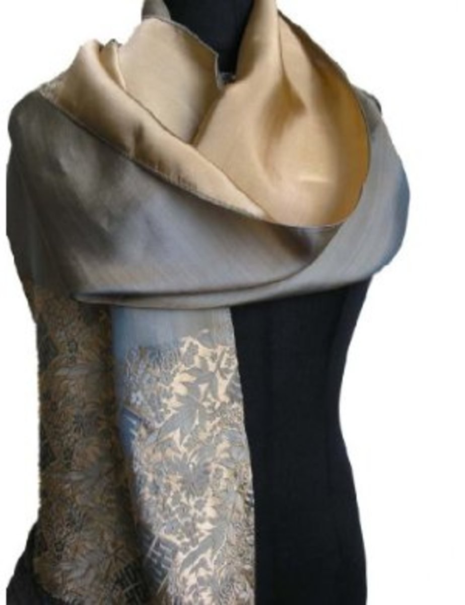 The rich texture of this silk and damask like pattern make this scarf very formal fashion statement.