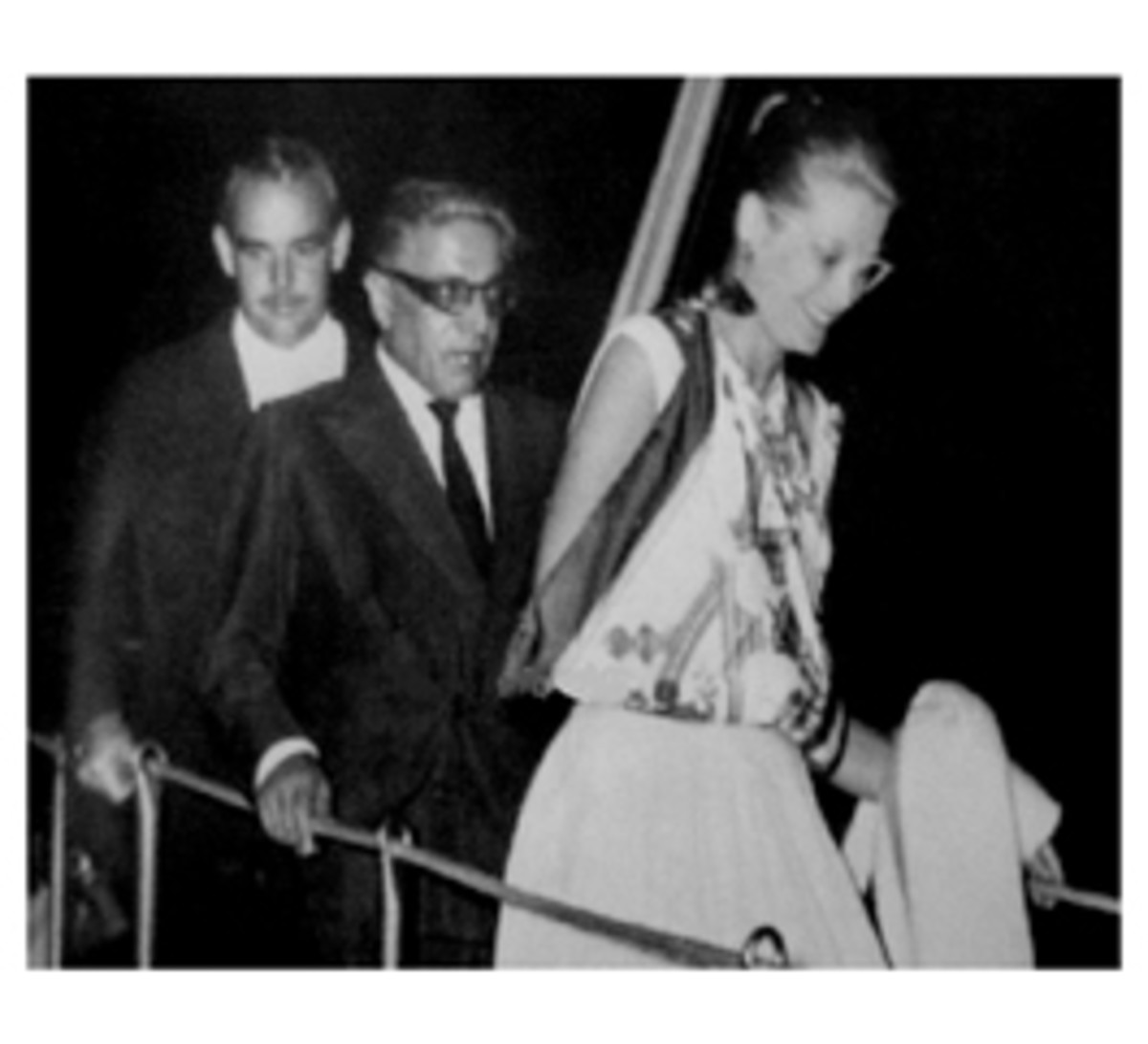 Princess Grace using a scarf for an arm sling - note the silk scarf is from the legendary French designer Hermes