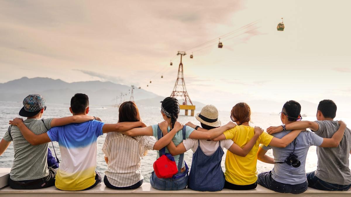 friends holding shoulders sitting together