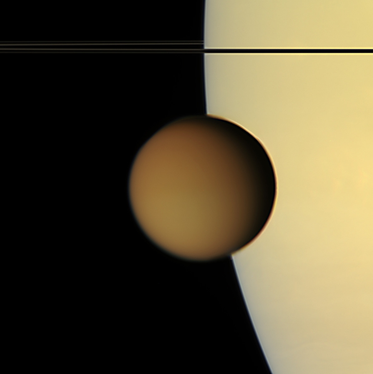 Titan, with Saturn in the background