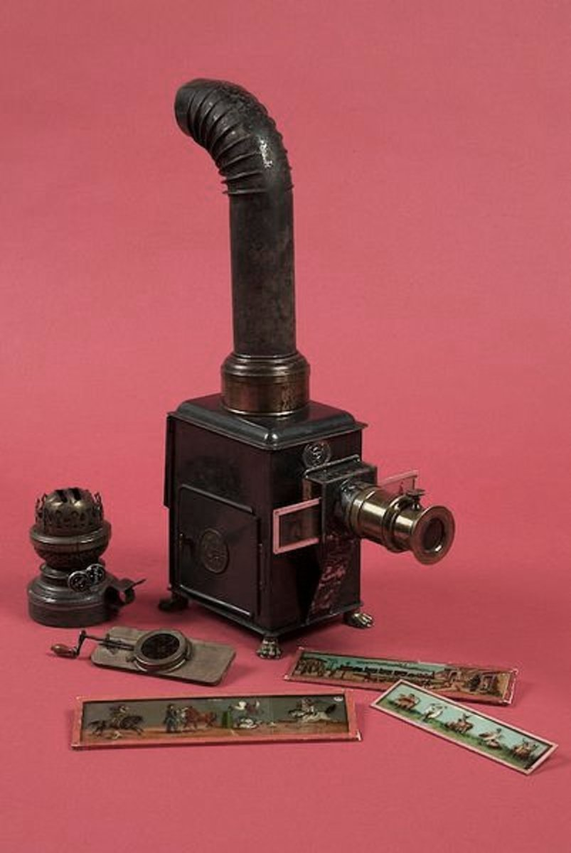 An early example of a magic lantern with a sample of slide images for projection