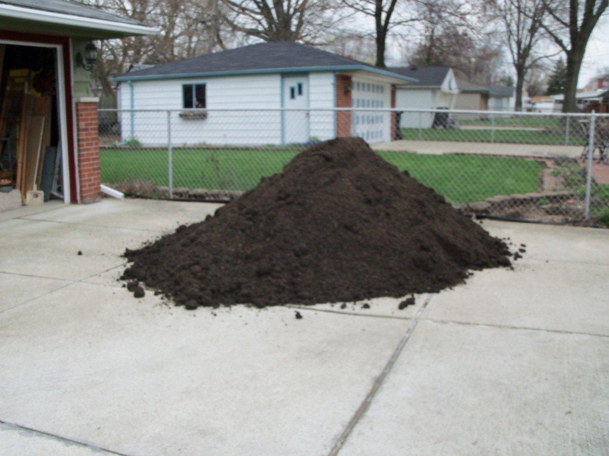 SECOND LAYER: GARDEN SOIL- 5 yards of garden soil mix delivered