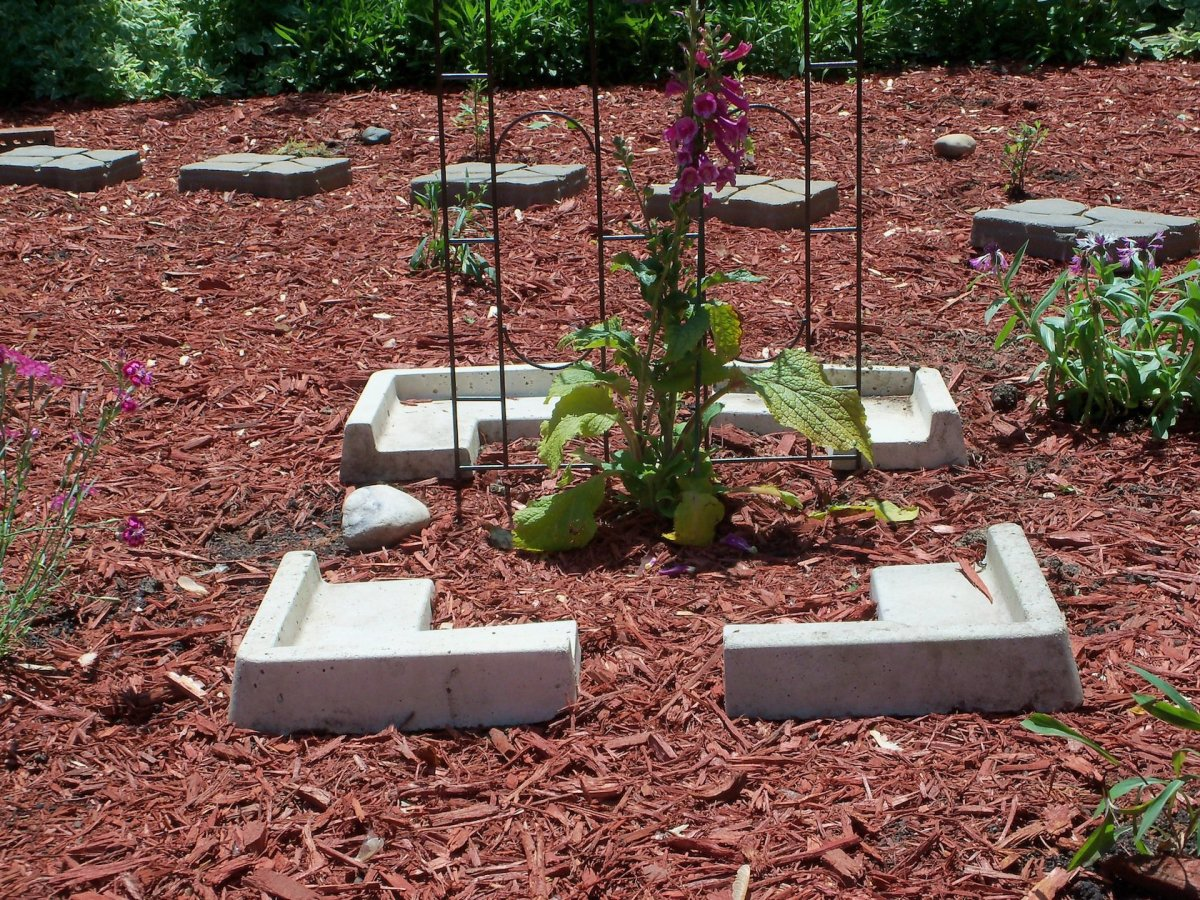 created another focal point with some corner stones I had and moved the bell trellis there