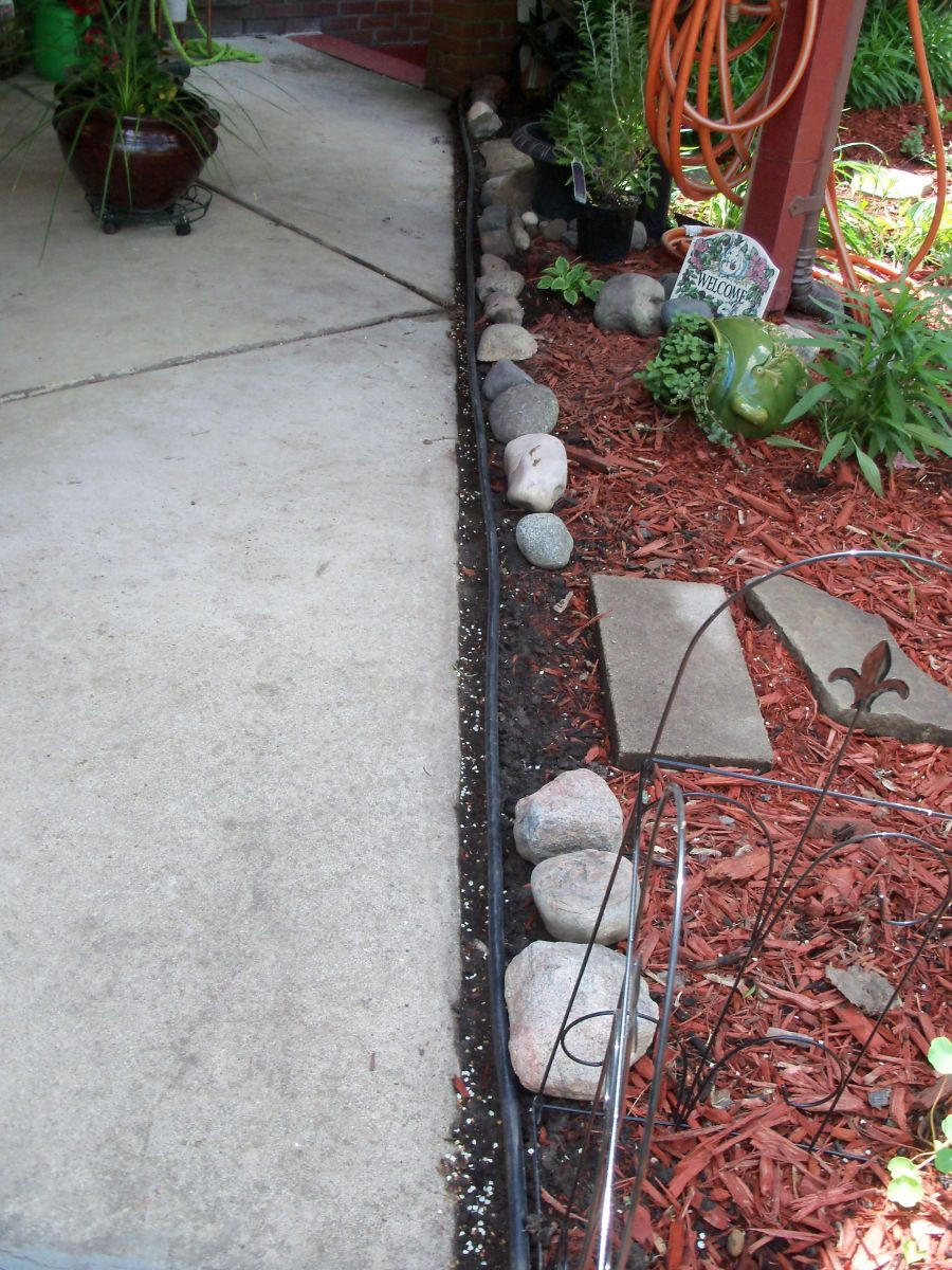 put in edging between garden and my back porch- added some rocks for appearance