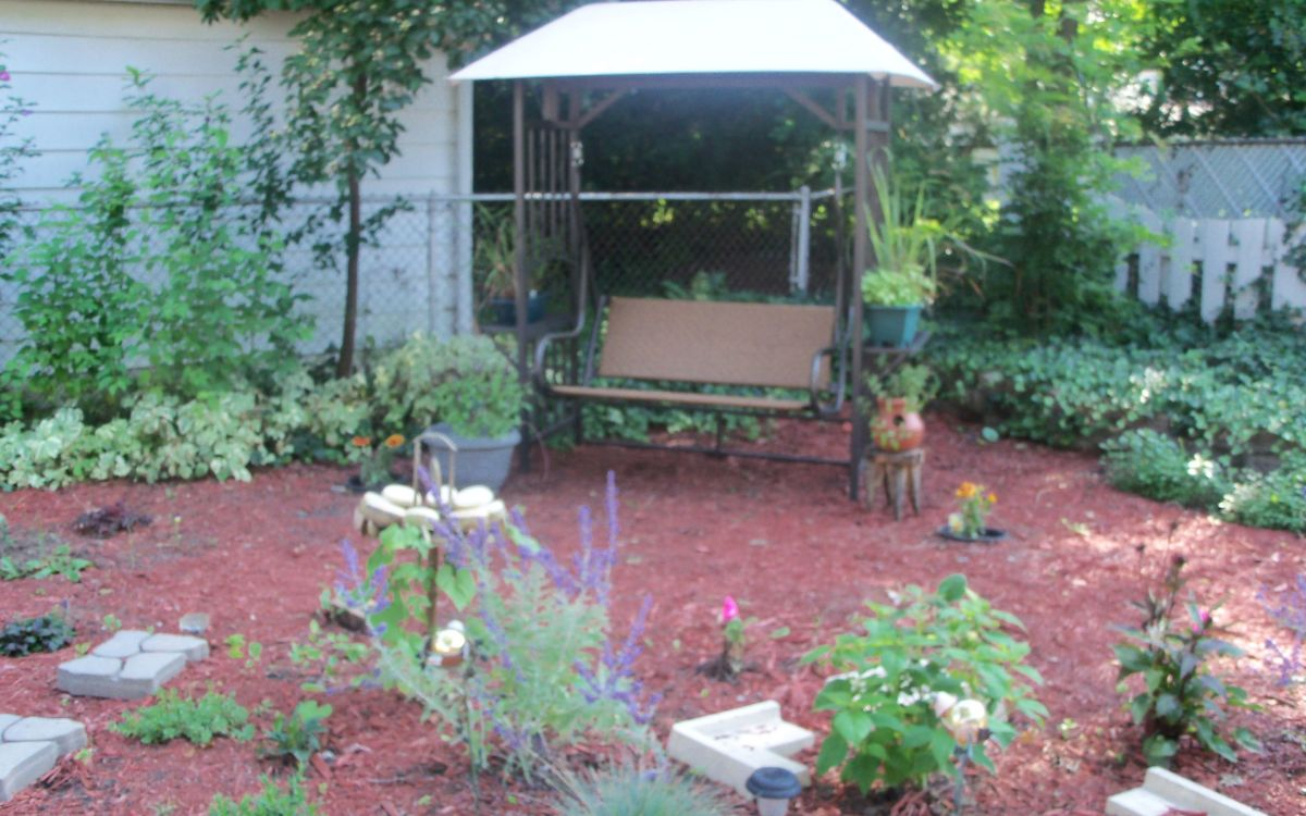 patio swing- great place to sit and enjoy the garden