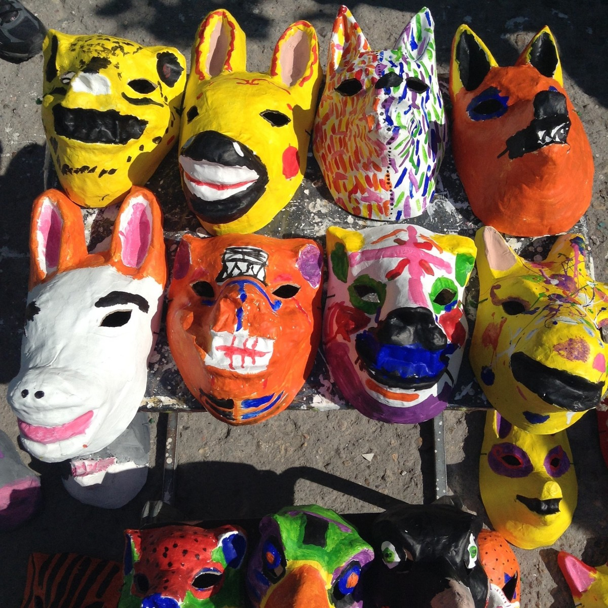 Assorted variety of full face paper mache masks.